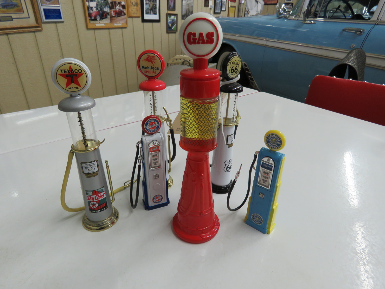 Grouping of Decorative Gas Pumps and Avon Gas Pump - Image 1