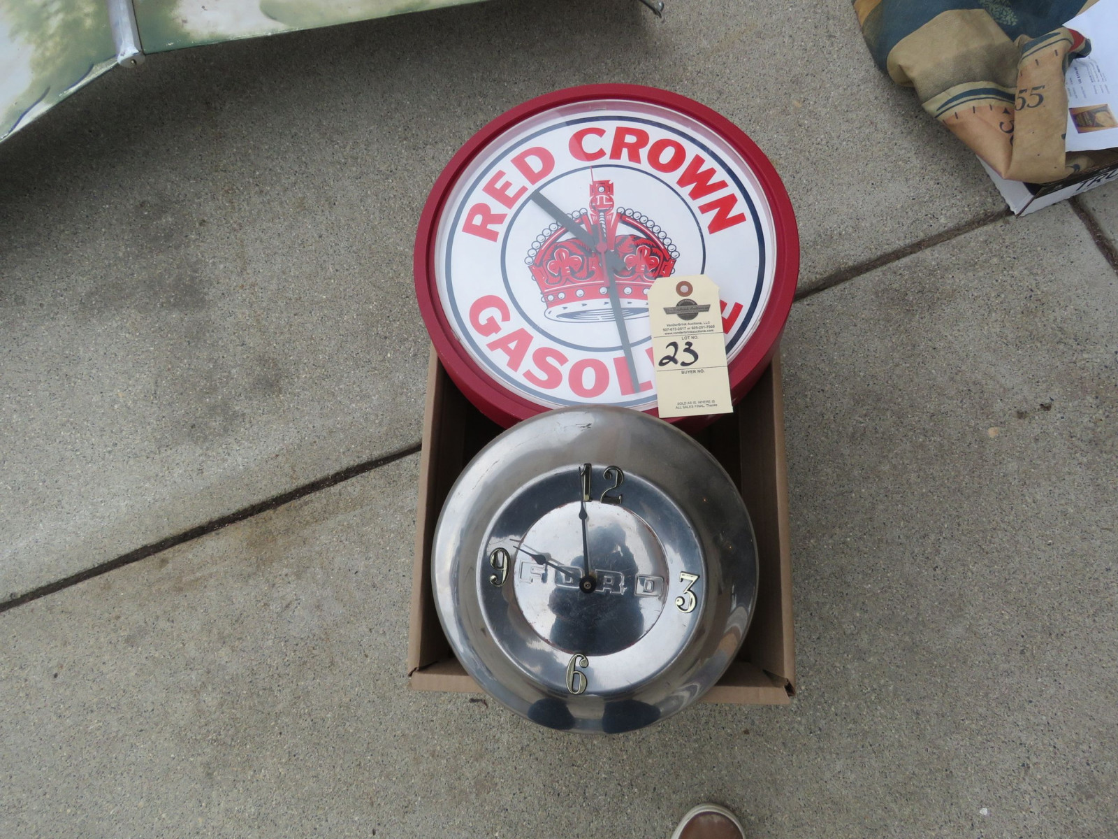 Ford hubcap Clock and Aftermarket Red Crown Clock - Image 1
