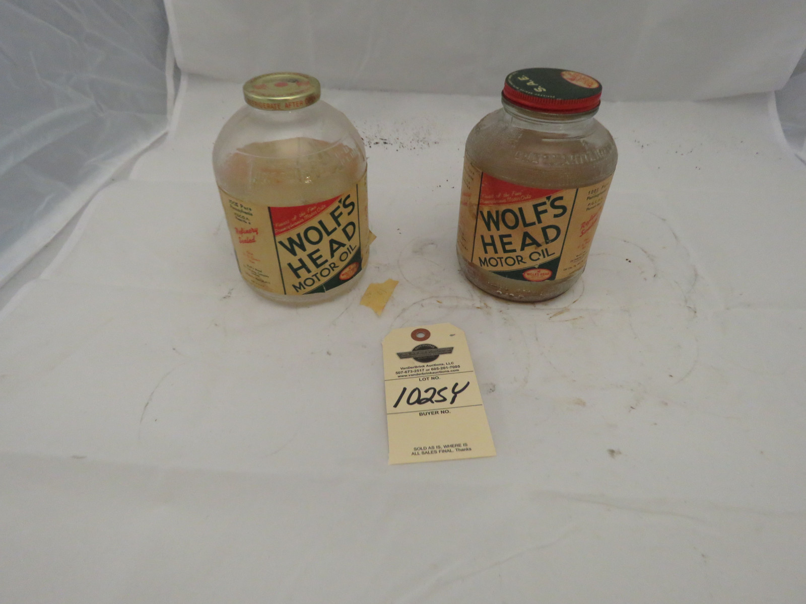 Wolfs Head Vintage Oil Bottles - Image 1