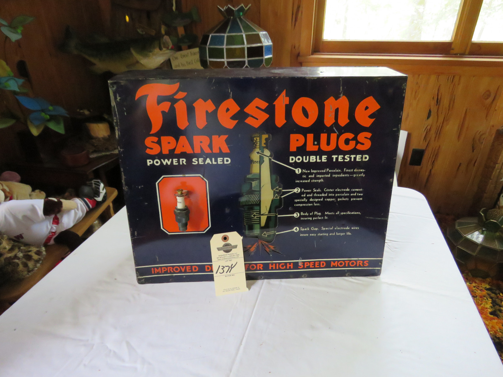 Vintage Firestone Metal Spark Plug Display - Image 1