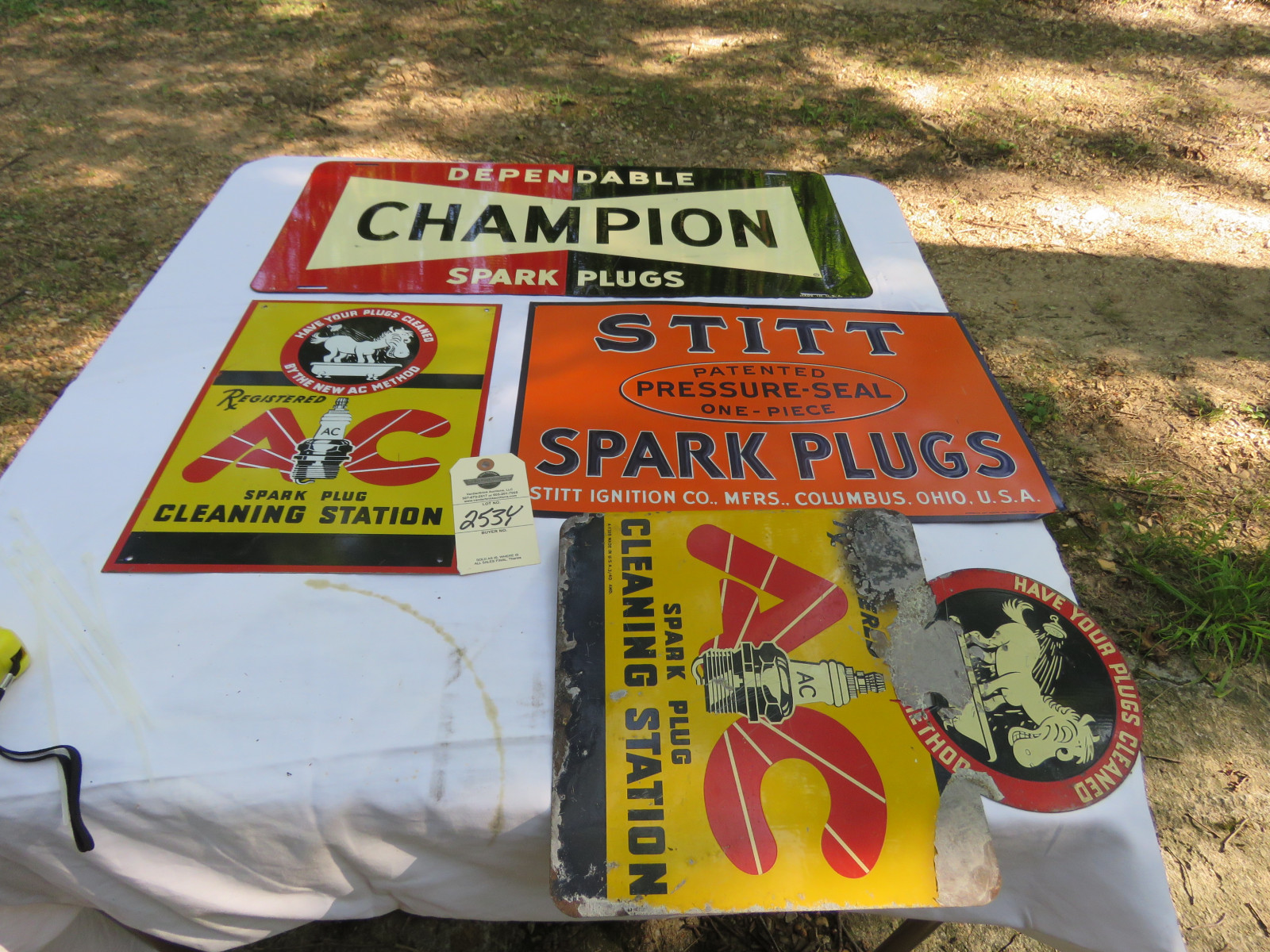 Vintage Painted Tin SS Spark Plug Sign Grouping - Image 1