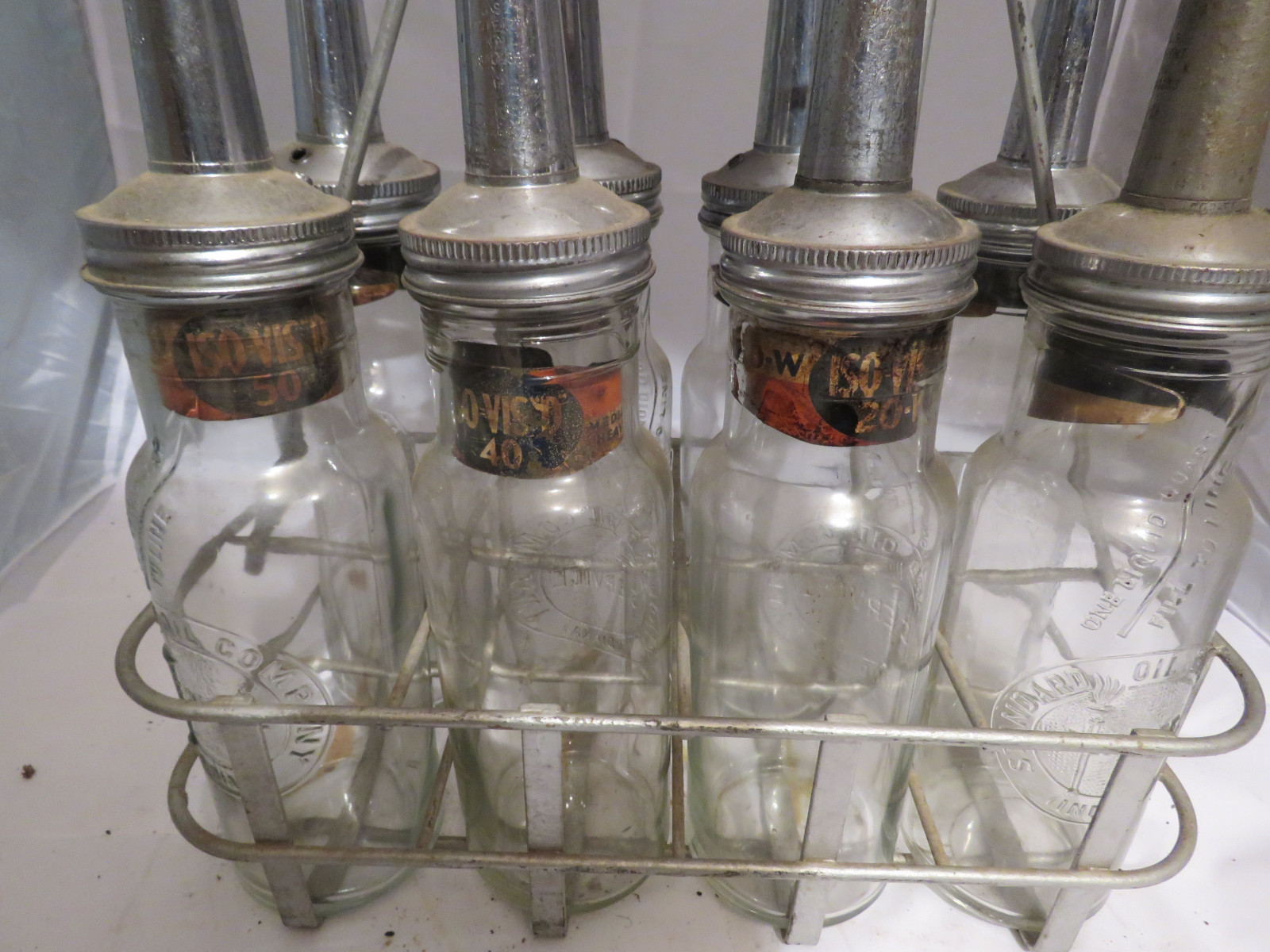 Vintage ISO VIS Glass Oil Bottle Grouping and Rack - Image 2