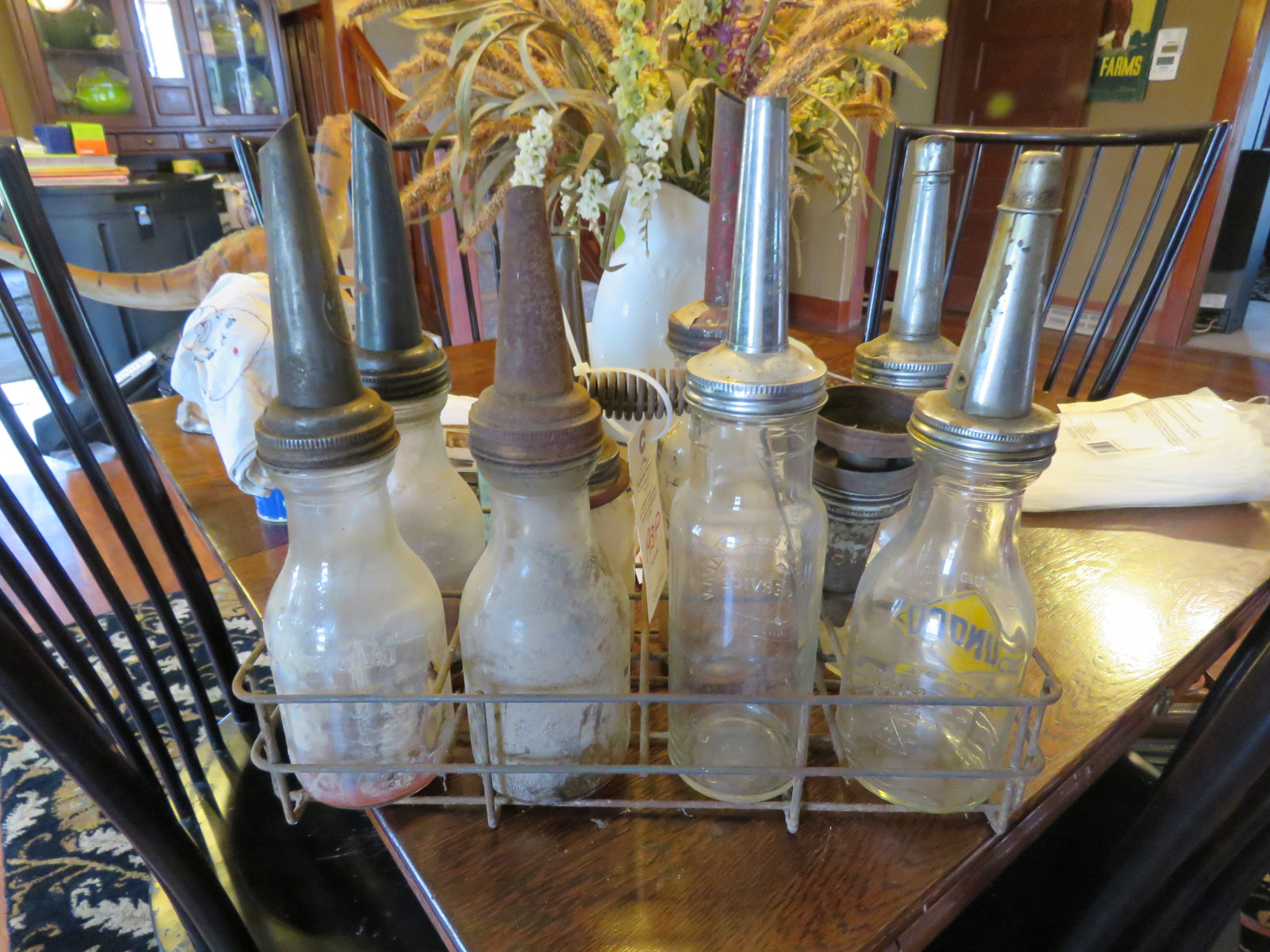 VINTAGE OIL RACK WITH ASSORTED 8 GLASS OIL BOTTLES - Image 1